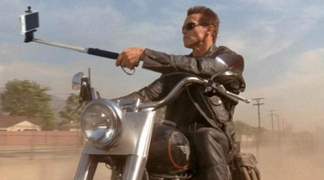 Photoshopped Selfie Sticks Replace Guns in Popular Movies