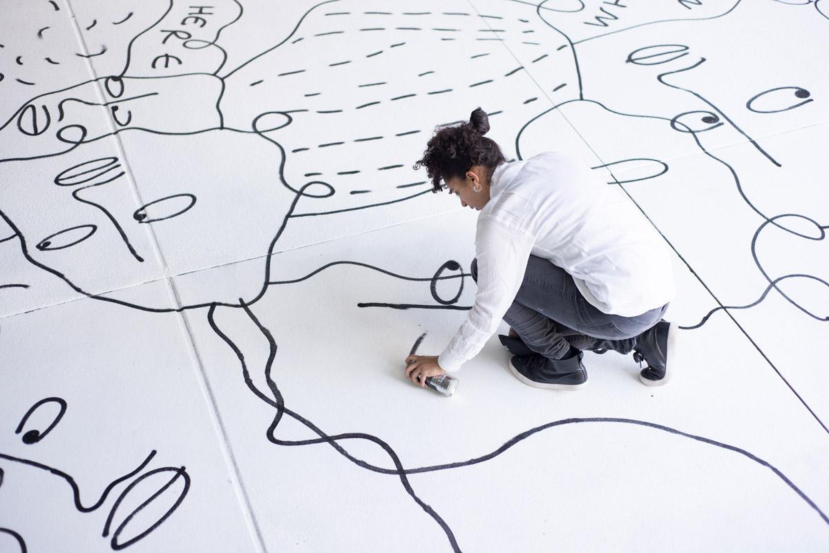Artist Shantell Martin at work