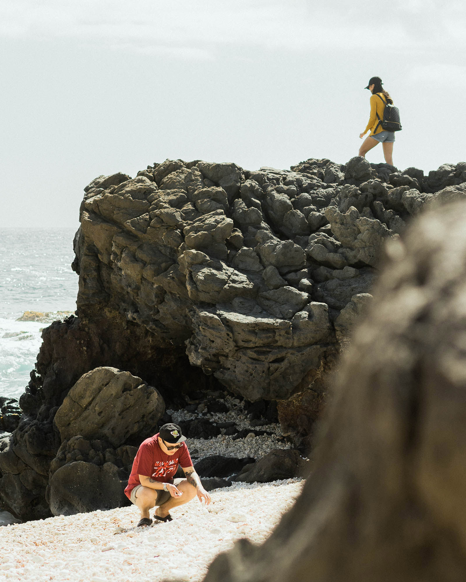 Artists Sixcoin and Tran Nguyen exploring Kaʻena Point, the western most tip of O'ahu.